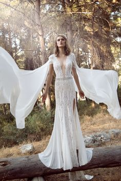 Galia Lahav Gala IV Collection GALA-906 GALA is their premium made-to-order bridal line, for the young vibed-bride, handmade with love in Tel-Aviv.  Sexy A-line dress with lace and a front slit, with a very low plunging v-neckline. It is adorned with embroidered appliques and trim and a crystal embroided belt around the waist. It comes with long chiffon detachable sleeves.