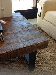 chunky wood coffee table; $699. Griffin Coffee Table | Pottery Barn ...