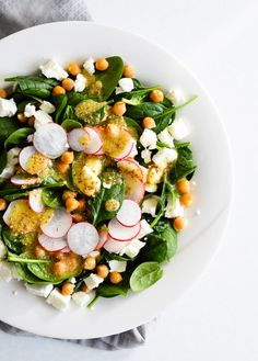 Crispy chickpea and spinach salad with feta, radishes, and mustard vinaigrette