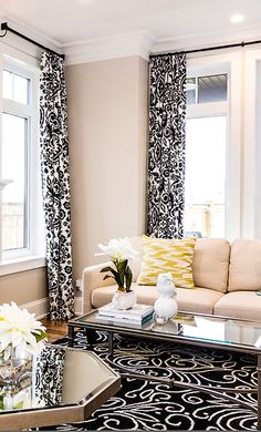 Black & White Suzani print make for gorgeous high contrast drapes in the elegant living room. Drapes by Tonic Living.  Design by www.lisaclarkdesign.net. Photo Credit: Cory Loewen