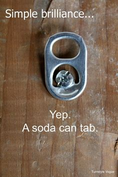 Use A Soda Can Tab As A Picture Hanger
