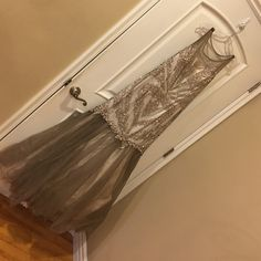 Size16 Royalqueen silver embellished mermaid dress Full tule skirt mermaid dress full body stone embellished sparkle is amazing perfect statement dress! Worn once runs slightly big Royal queen Dresses Prom