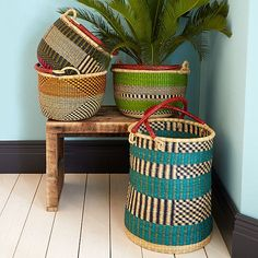 Bolga Baskets (African - similar to Cherokee) Bold baskets. Handwoven in Ghana from colorfully-dyed grasses, the Bolga Baskets are topped with goat-hide leather handles. Home Decor Baskets, Basket Decoration, Eclectic Baskets, Boho Living Room, Home And Deco, Basket Weaving, Woven Baskets, Picnic Baskets, Wire Basket