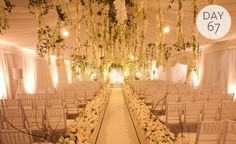 Mindy Weiss just has a way of creating fairy-tale wedding designs and this is one of them. Mindy and team brought the outdoors in by hanging flower-laden vines from a chic all-white ceiling. Lining...