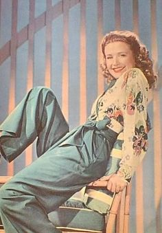 Priscilla Lane wearing her pants with a floral printed blouse (1940s)