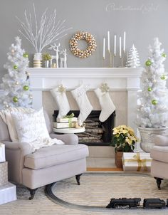 A fresh and neutral scheme for Christmas - taupe, grey, white, gold, and a hit of vibrant green set the festive scene in this living room.