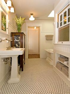 The baths are in the style of the early 20th century: all white, with hex tile on the floor and high beadboard walls. Description from pinterest.com. I searched for this on bing.com/images