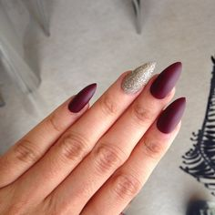 Gorgeous matte burgundy stiletto nails with a gold glitter feature