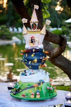 Though this Mario Galaxy cake is technically a wedding cake it would also make an extravagant groom's cake. For a more normal sized groom's cake, any of the three featured scenes would still look great on their own! | Groom's Cake Ideas