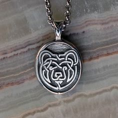 """Celtic Bear Pendant. I don't see a lot of Celtic bears, so this is unique. The inscription on the back reads, """"Strength-Compassion-Courage- Widom""""  