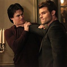 The Vampire Diaries....Elijah choking Damon & looking so sophisticated doing it too!!