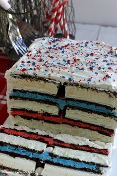 Ice Cream Sandwiches Cake -- this fun red, white and blue ice cream sandwiches cake is super easy and really fun for your 4th of July Celebrations! Just 4 simple ingredients and you have a show-stopping dessert!