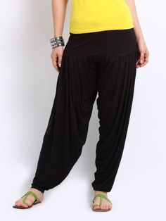 Patiala pants are lightweight and flowy but cinch at the ankles to prevent dust and dirt clinging to the hems. Patiala Pants, Patiala Salwar, Harem Pants, Trousers, Indian Fashion, What To Wear, Female, Amazing, Skirts