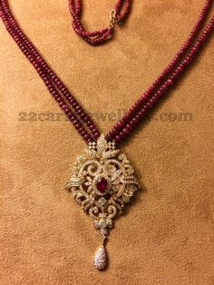 Small ruby beads chains intricate medium size necklace with designer diamond pendant. Studded with ruby stone in the center. Hanging with diamond drops. Pearl Necklace Designs, Beaded Jewelry Designs, Gold Earrings Designs, Gold Jewellery Design, Bead Jewellery, Jewelry Patterns, Jewelry Necklaces, Jewellery Shops, Gemstone Necklace