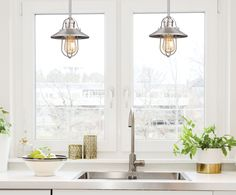 Have you been cooking up anything new and delicious lately? A pair of nautical style Minka-Lavery pendants helps to illuminate this lovely kitchen sink area (and the greenery from the 🌿s and 🍏s certainly helps). Farmhouse Pendant Lighting, Kitchen Lighting Fixtures, Home Lighting, Lighting Ideas, Mini Pendant Lights, Cozy Place, Minka, Easy Projects, Home Improvement Projects