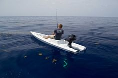 Solo Skiff, A fishing kayak, skiff, and SUP in one.