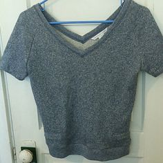 Victorias Secret Short Sleeve Gray Sweater Top Great condition gray short sleeve sweater by Victoria's Secret size xsmall. It runs a little short, depending on height (prob 5'5 & up) it could end up being semi cropped. No defects. If you're worried about fit, feel free to ask for measurements but please don't leave me neutral / negative feedback because the item doesn't fit! =) Victoria's Secret Sweaters V-Necks