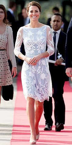 FLOWER GIRL  Again beating the heat in a lightweight, sheer-sleeve dress and a pretty updo, Kate visits Kuala Lumpur's British High Commission in an ice-blue Temperley London dress and her standby L.K. Bennett pumps.