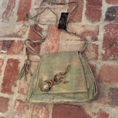 Fancy Nancy luxurious leather purse with tags Greenish-goldish-bronze. Great purse with brass ornate fixture and clear stone... Snap magnetic flap closure... Zip inside pocket and 2 separate areas Fancy Nancy Bags