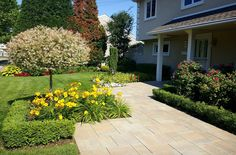 This home's main entryway was created using pavingstones from Cambridge pavers. Installation: Design and Build Landscape
