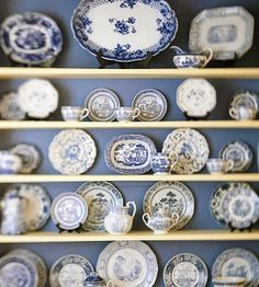 Blue and white wall of china - Would look great with contrasting color (very light yellow for example) behind plates instead of trying to match plates.