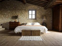 Love the stone and white bed spread.