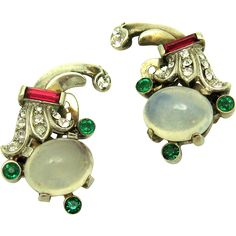 Beautiful 1948 Trifari sterling moonstone clip earrings designed as a companion to Trifari's Talisman brooch.  They feature a prong set faux moonstone