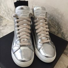 Marc By Marc Jacobs Silver Metallic Sneaker Marc Jacobs Silver Metallic Lace Up Sneaker 7m  Features * 100% Leather * Imported * rubber sole * Mark Jacobs blends retro attitude with 21st century shapes in this laid-back leather shoe * Dust cloth  Worn once. Great condition. Very little signs of wear. Marc by Marc Jacobs Shoes Sneakers