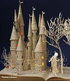 We're wondering if the artist used a fantasy book to create this amazing book art. Just looking at it reminds us of bedside stories! For big kid bedside stories (or daytime stories :) check out our selection at RicherResourcesPublications.com