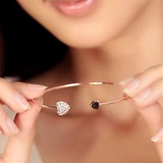 Gold Heart Bracelet Super cute gold toned zinc alloy bracelet with clear rhinestones! New in package. Jewelry Bracelets
