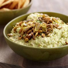 Goat Cheese-Edamame Dip with Spiced Pepitas | Canned chipotles in adobo sauce give this clever, creamy dip an enticing heat and smokiness. The spiced pepitas (roasted and salted pumpkin seeds) scattered over the dip are addictive and great as a snack on their own.