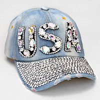 This is a stunning rhinestone baseball hat.  It is super blingy with dozens of rhinestones.  It is a light blue jean cap. The gems in USA are either clear (as pictured) or colored.   USA SUPER BLING BLUE JEAN RHINESTONE BASEBALL HAT $17.99 www.nanascountryrusticshop.com www.facebook.com/nanascountryrusticshop