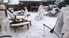 Snowmen taking in a little refreshment at the local Pub's beer garden in England