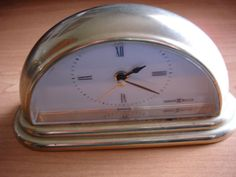VINTAGE HOWARD MILLER CLOCK SMALL WITH SECOND HAND ALARM AND LIGHT BRASS WORKS
