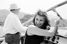 Sophia Loren with her husband, Carlo Ponti, on a boating trip off of Naples, 1961.