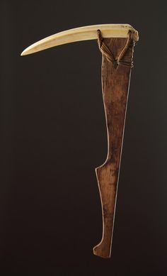 A Rare Inuit Sprucewood and Walrus Ivory Pickaxe