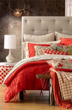 loving the way this bright coral color looks with these beautiful neutrals. Such a pretty bedroom!