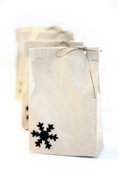 Snowflake (or any other pattern) hole-punch stuck to bottom left corner of bag. Circle hole-punch top right corner and secure with twine (*R*)