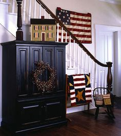 ..Old-Glory-inspired........ this is a great example of using what you have to get this look. I have an old entertainment center that we use for storage, paint it black,i have the small rocker, the house on top and of course small items to sit around.