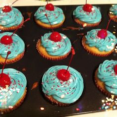 4th of july alcohol infused cupcakes! White cake baked with champagne, white chocolate ganache filling with cotton candy vodka, blue cotton candy frosting with cotton candy vodka, red sprinkles, and cherries soaked in bourbon.