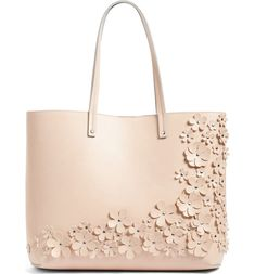 This versatile tote cut from smooth faux leather is detailed in delicate, studded floral appliqués for a feminine flourish. Diy Purse, Tote Purse, Tote Handbags, Purses And Handbags, Studded Handbags, Studded Purse, Clutch Bags, Tote Bags, Leather Purses