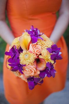bridesmaid bouquet- love the purple orchids/orange dahlias, orange callas against the persimmon dress! image by cathy stancil flowers by winecountryflowers.com
