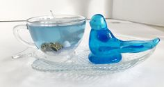 White Tea and Ginger Scented Seascape Gel Candle Resting on Unique Fish Plate Blue Bird Crafts With Glass Jars, Jar Crafts, Gel Candles, Glass Tea Cups, Fish Plate, Blue Plates, Seashells, Starfish, Blue Bird