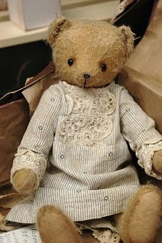 Dressing your Teddy up in your old baby clothes.