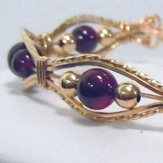 This bracelet is stunning! It is made to order featuring round garnet gemstones, gold fill beads and wire. Garnet is the birthstone for January.