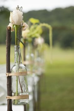 Rose Aisle Decor in Glass Bottles   Mandy Owens Photography https://www.theknot.com/marketplace/mandy-owens-photography-albertville-al-498979