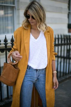 Emma Hill wears Mustard duster coat, cropped frayed jeans, basic white t shirt, Simon Miller Bonsai bag, summer outfit Yellow Jacket Outfit, Yellow Coat, Yellow T Shirt, Fall Fashion Outfits, Fall Winter Outfits, Casual Outfits, Women's Fashion, Look Kimono, Mustard Shirt