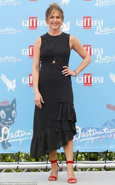 Leading lady:Jennifer Aniston certainly dressed for the spotlight as she arrived for the ...