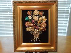 Jewelry Art. A beautiful picture, 14.5 x 12.5 inches made entirely from jewelry, mostly vintage. Its a bouquet of flowers, with lots of