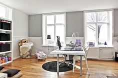 Bedroom/office. Beautiful grey walls, and pink/purple details.